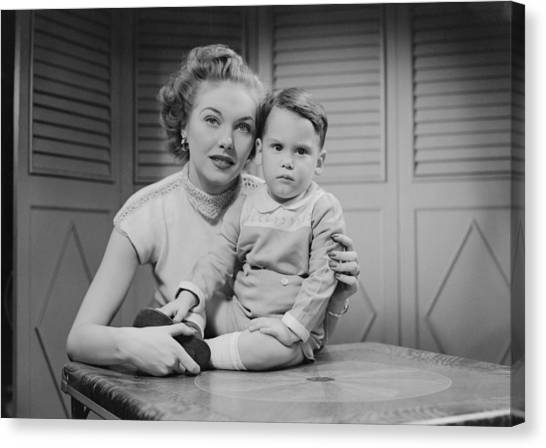 Mother Embracing Son (2-3) Indoors, Portrait Canvas Print by George Marks