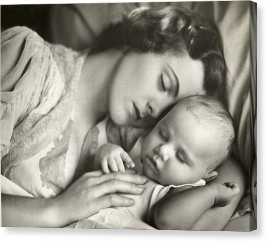 Mother Holding Infant In Bed Canvas Print by George Marks