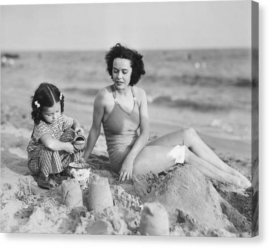 Mother With Girl (2-3) Playing In Sand On Beach, (b&w) Canvas Print by George Marks