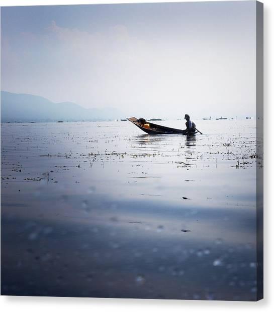 Rain Canvas Print - Myanmar Fisherman by Nina Papiorek