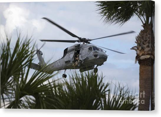 Fort Pierce Canvas Print - Navy Seals Look Out The Helicopter Door by Michael Wood