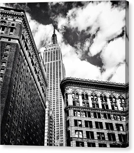 Times Square Canvas Print - New York City - Empire State Building And Clouds by Vivienne Gucwa