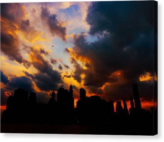 City Sunsets Canvas Print - New York City Skyline At Sunset Under Clouds by Vivienne Gucwa