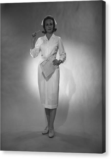 Nurse Holding Medical Chart Posing In Studio, (b&w), Portrait Canvas Print by George Marks