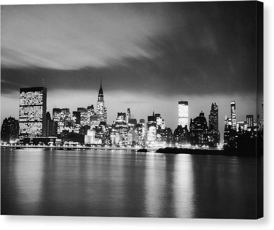 Nyc Skyline At Night Canvas Print by George Marks
