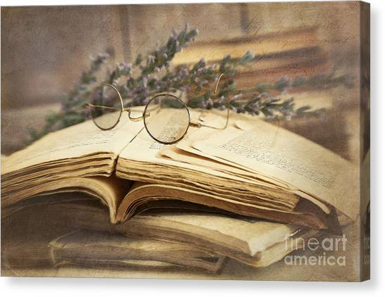 Old Books Open On Wooden Table  Canvas Print