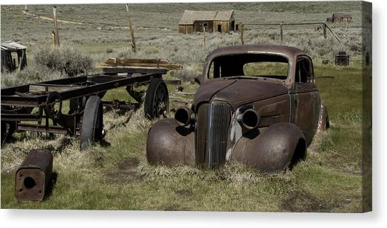 Old Rusted Car Canvas Print by Richard Balison