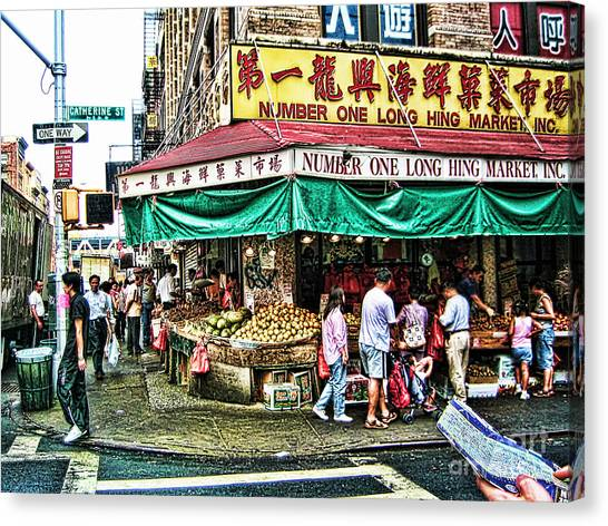 On Tour In Chinatown-nyc Canvas Print by Anne Ferguson