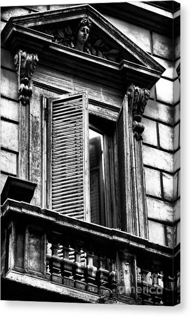 Open Shutter In Rome Canvas Print by John Rizzuto