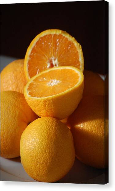 Orange Halves Canvas Print by Dickon Thompson