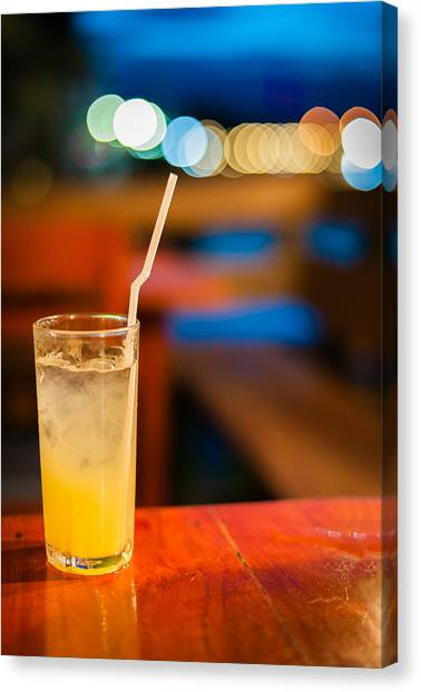 Orange Juice On Table Wilth Color Of Light Canvas Print by Kittipan Boonsopit