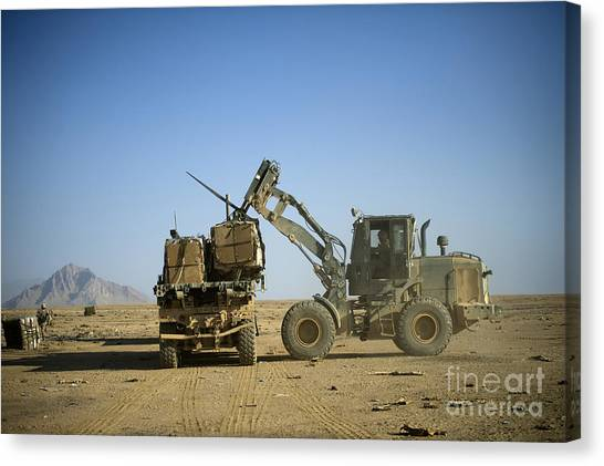 Forklifts Canvas Print - Pallets Of Food Rations Are Loaded Onto by Stocktrek Images