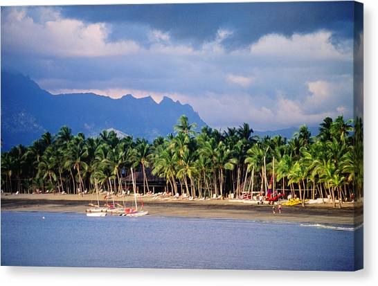 Palms And Beach, Sheraton Royale Hotel, Fiji Canvas Print by Peter Hendrie