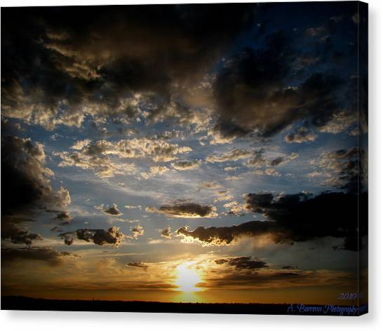 Partly Cloudy Skies At Sunset Canvas Print by Aaron Burrows