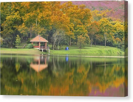 Pavillion In The Autumn Park  Canvas Print by Anek Suwannaphoom