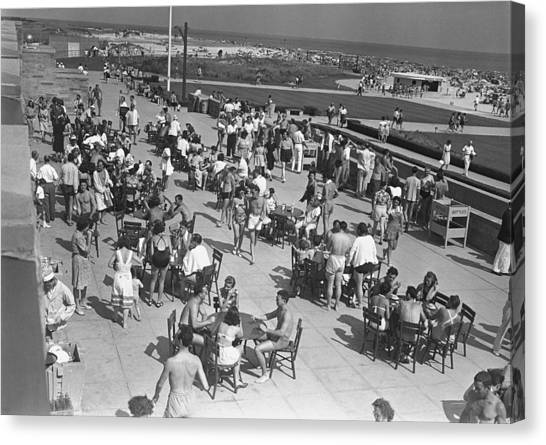 People Sitting At Tables By Beach, (b&w), Elevated View Canvas Print by George Marks