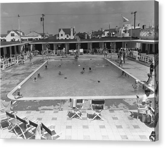 People Swimming In Pool, (b&w), Elevated View Canvas Print by George Marks