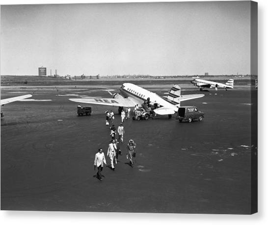 People Walking On Runway, (b&w), Elevated View Canvas Print by George Marks