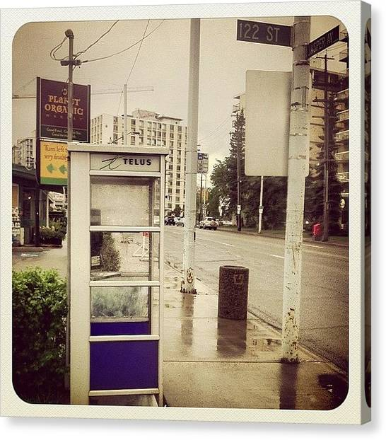 Street Signs Canvas Print - Phone Booth Outside An Organic Market On Jasper Ave In Edmonton by Eric Dick