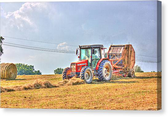 Picking Up Hay Canvas Print by Barry Jones