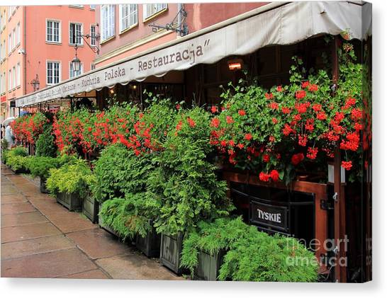 picturesque restaurant terrace in Gdansk Poland Canvas Print by Sophie Vigneault