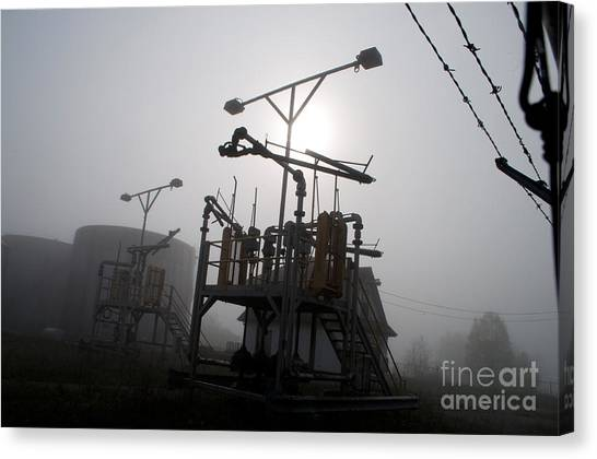 Platforms And Tanks At Petrocor In The Fog Canvas Print by Gary Chapple