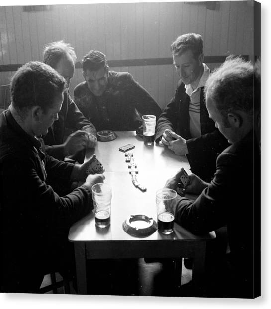 Playing Dominoes Canvas Print by John Drysdale