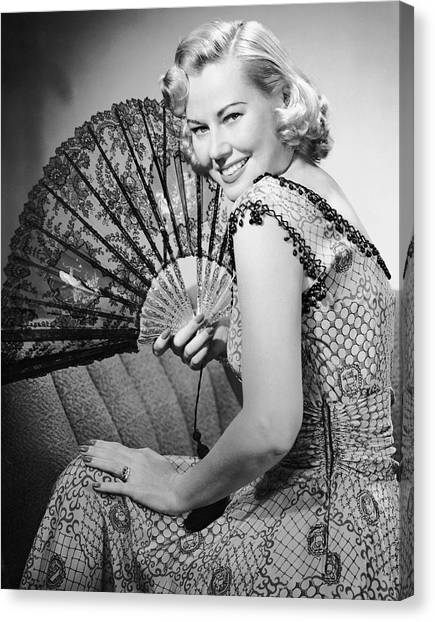 Portrait Of Blonde Woman Holding Fan Canvas Print by George Marks