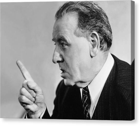 Portrait Of Mature Man Speaking With Authority Canvas Print by George Marks