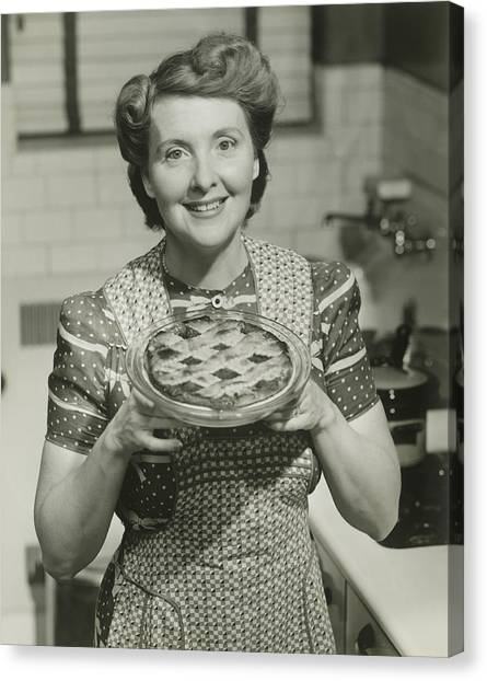 Portrait Of Mature Woman Holding Pie Canvas Print by George Marks