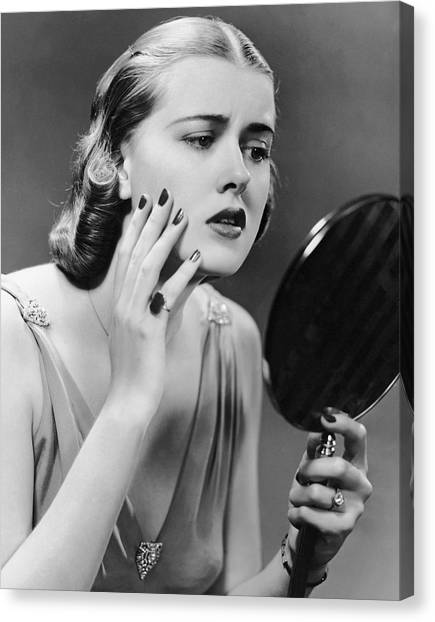 Portrait Of Upset Woman Looking In Hand Mirror Canvas Print by George Marks