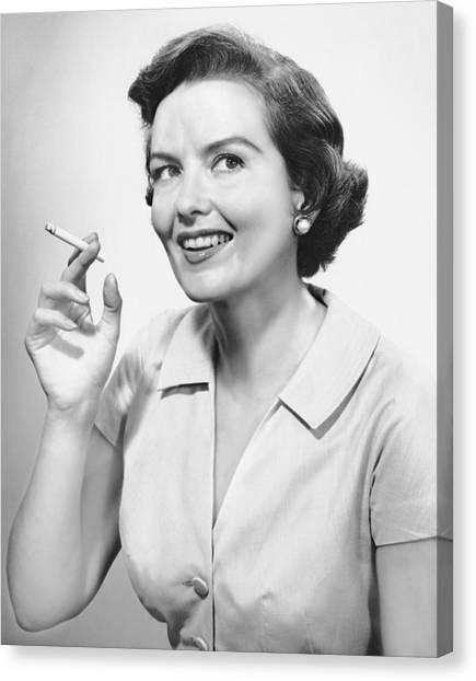 Portrait Of Woman Holding Cigarettte Canvas Print by George Marks