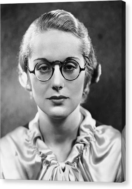 Portrait Of Woman Wearing Eyeglasses Canvas Print by George Marks