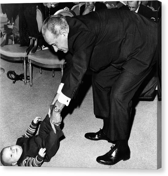 President Lyndon Johnson Tugs The Legs Canvas Print by Everett