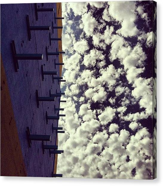 Installation Art Canvas Print - Pretty Skies Above The Art Installation by Arnab Mukherjee