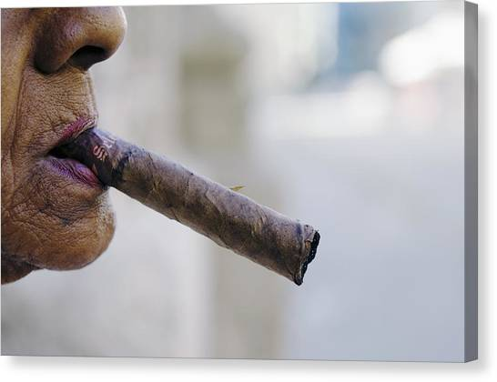 Profile Of Cuban Woman Smoking Cigar In Vieja District Canvas Print by Christian Aslund