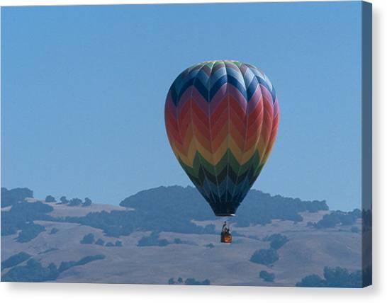 Rainbow Balloon Over Hills Canvas Print