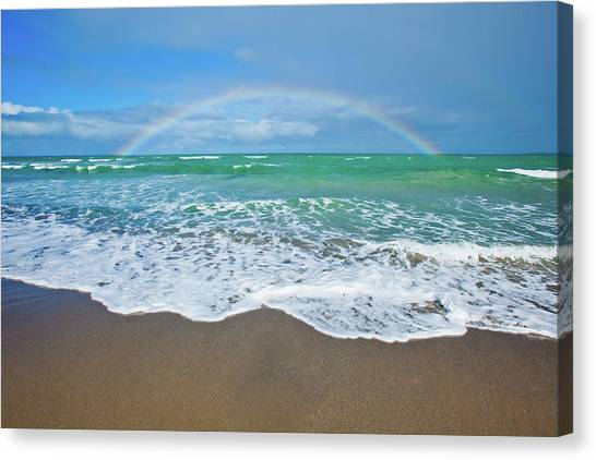 Rainbow Over Ocean Canvas Print by John White Photos