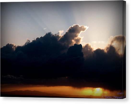 Rays Of Light Over Mount Taylor Canvas Print by Aaron Burrows