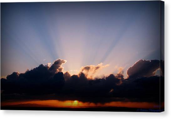Rays Of Light Through The Storm Canvas Print by Aaron Burrows