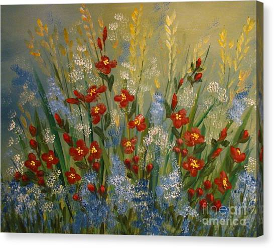 Red Flowers In The Garden Canvas Print