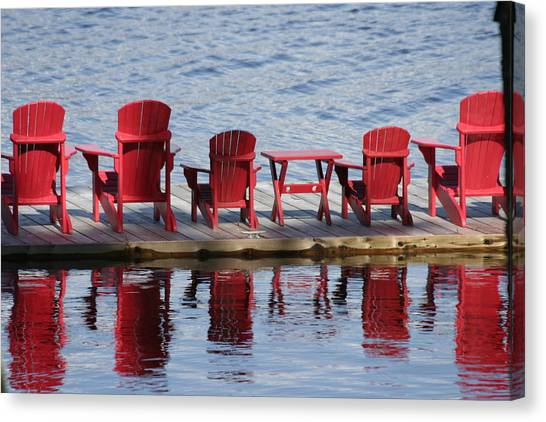 Red Muskoka Chairs Canvas Print by Carolyn Reinhart