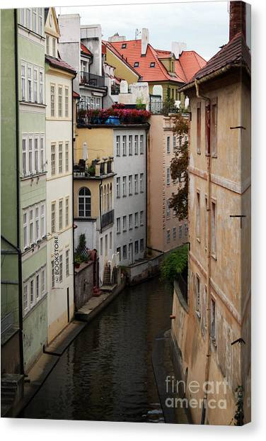 Old World Canvas Print - Red Rooftops In Prague Canal by Linda Woods