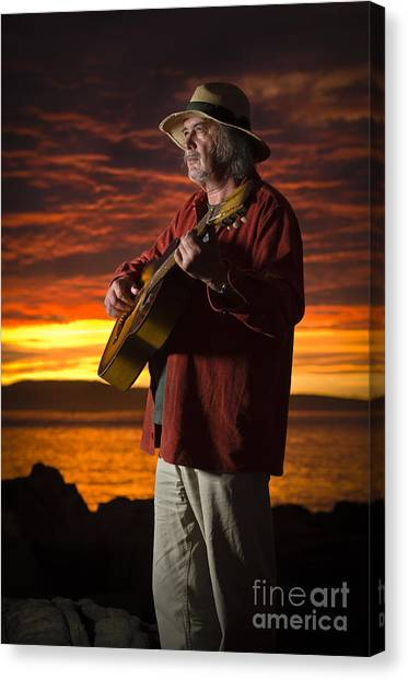 Red Sky Guitarist Canvas Print by David Lade