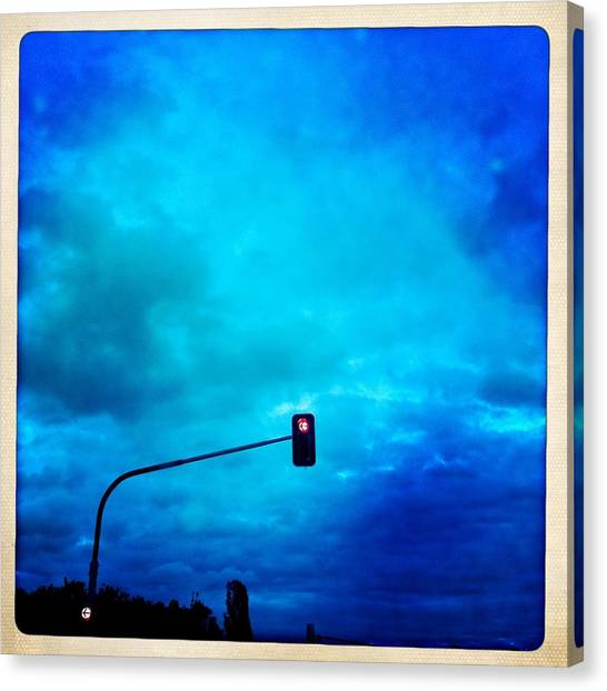 Light Canvas Print - Red Traffic Light And Cloudy Blue Sky by Matthias Hauser