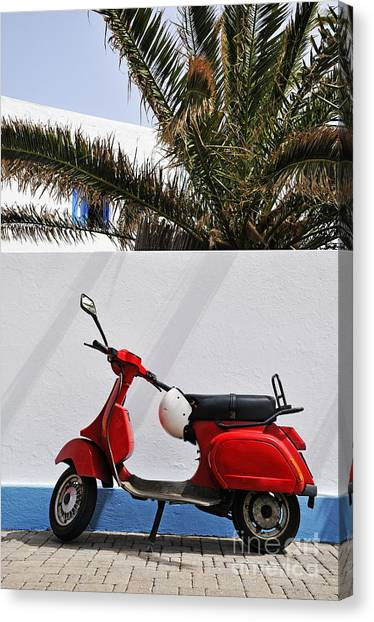 Red Vespa By Wall Canvas Print by Sami Sarkis