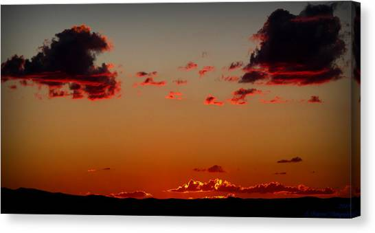 Reds Of An Autumn Sky Canvas Print by Aaron Burrows