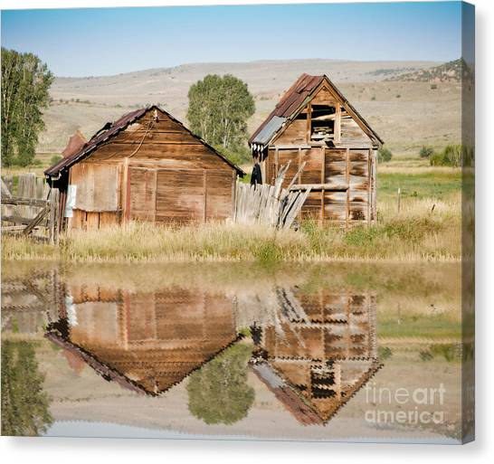 Reflection Of An Old Building Canvas Print