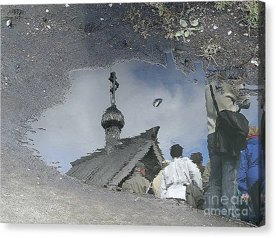 Reflections In A Rain Puddle Canvas Print