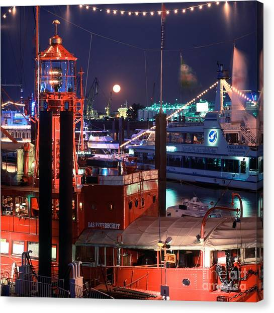Rising Moon Over Lightship Canvas Print by Serge Fourletoff